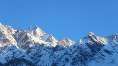Sunshine on mountain tops! (solarisgirl) Tags: kalga himachalpradesh snow white mountain peak rocky sunshine sunrise blue