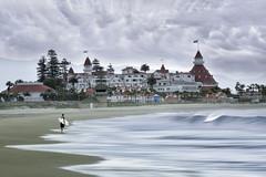 Grandeur by the Sea (Lee Sie) Tags: sky clouds water pacific ocean sea wave surfer hotel del coronado
