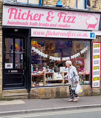 Brighouse 007 (Peter.Bartlett) Tags: bag shopfront unitedkingdom people stick facade olympuspenf westyorkshire door peterbartlett urban candid uk m43 microfourthirds shopwindow woman sign walking streetphotography colour brighouse england