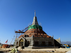 Building a new temple in Nyaungshwe, Myanmar (Claire Backhouse) Tags: temple religion worship culture burma burmese work working myanmar buddha buddhism buddhist stupa bluesky ladder heights high building buildings construction architecture scary umbrella