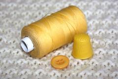 Yellow Button. (Yesteryear-Automotive) Tags: knitting sewing button cotton thread cardigan thimble yellow smileonsaturday yellowonwhite