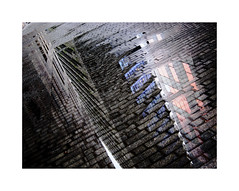 Cobblestones (BLANCA GOMEZ) Tags: spain bcn barcelona avenidadiagonal urban street arquitectura architecture contemporary towers offices housing glass windows reflection cobblestones rain lluvia water charco pond light shadows textures shapes silhouettes