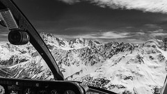 Heli ride to snowy mountains (wooiwoo) Tags: clouds helicopter helicopterflight monochrome mountains newzealand nz rock snow southisland southernalps