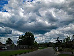 Clouds Above Independence Drive. (dccradio) Tags: lumberton nc northcarolina robesoncounty outdoor outdoors outside nature natural cloud clouds cloudformation saturday april spring springtime saturdayafternoon afternoon goodafternoon weekend sky bluesky cloudy street road independencedrive tree trees treebranch branch branches treebranches landscape grass lawn greenery foliage treelimb treelimbs canon powershot a3400is mailbox van fence woodfence woodenfence paved pavement