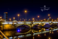 Belfast by night (Kyle TKT) Tags: belfast nightphotography slowshutter lights reflection northernireland nightscape bridge streetlights nightime queensbridge titanicquarter cathedralquarter