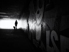 silhouette (Sandy...J) Tags: olympus atmosphere tunnel urban underpass germany grafitti blackwhite bw backlight silhouette light darkness monochrom women dog street streetphotography sw schwarzweis strasenfotografie stadt city contrast noir absoluteblackandwhite