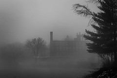 The Mill on the River in Richmond (jessicalowell20) Tags: kennebecriver richmond black blackandwhite fog gray industry maine mill mist newengland northamerica river spring trees water waterfront white