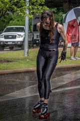 Skater Girl In The Rain (burnt dirt) Tags: houston texas art car parade street streetphotography candid portrait woman man girl sexy boobs young latina asian blonde brunette redhead tights leggings yogapants city town couple lovers friends tattoo downtown pretty beautiful selfie fashion style people person costume cosplay bokeh outdoor shadow sunny rainy documentary xt3 fujifilm cute boots heels skates ponytail long short hair model park skater rain wet