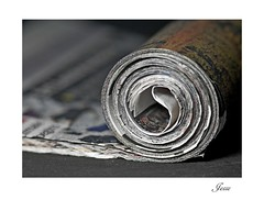 Roll Out the News (jesse1dog) Tags: newspaper roll tabletop circles spiral gm1 pentaxauto110 pentax 70mm bokah vintageprime paperstrip