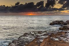 Sunrise Seascape (Merrillie) Tags: daybreak sunrise nature water avocabeach clouds rocky centralcoast newsouthwales rocks earlymorning nsw morning sea ocean sunrays landscape waterscape coastal waves sky seascape dawn coast australia outdoors