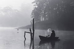 A fisherman was smoking in his leisure time (longtnguyen) Tags: dalat vietnam boat fisherman fog foggy forest grass lake lakeside lakeview landscape mist sunrise travel tree