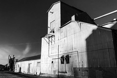 Siding (JCTopping) Tags: agriculture rail barn sunset architecture iphonex blackandwhite decay rural bargersville indiana unitedstatesofamerica