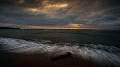 Woodbine Beach (Faron Dillon) Tags: lake ontario woodbinebeach toronto water waves kew slowshutter sony a7riii canon ef1740 metabones clouds cloudy stick log sand nature morning sunrise canada nisi polarizer