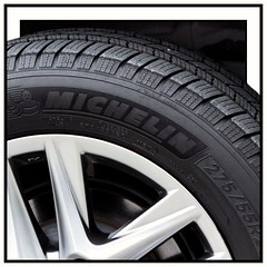 Art of travel (MoparMadman63) Tags: pneumatic rubberized tread pattern text commercial tire rim wheel car automotive travel artistic viewpoint expressive clean new abstract framed