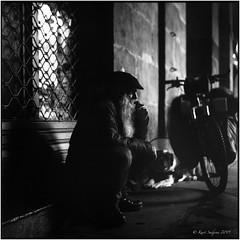 Plaza Nueva at night_Rolleiflex 3.5B (ksadjina) Tags: 6x6 bilbao easter kodak100tmax nikonsupercoolscan9000ed plazanueva rodinal rolleiflex35b semanasanta silverfast spain analog atmosphere beggar blackwhite dog film night scan spring basque