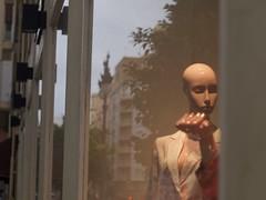 City blues (Riccardo Mori) Tags: olympus e420 mf mannequin shopstore glass lamp building tree hand valencia street