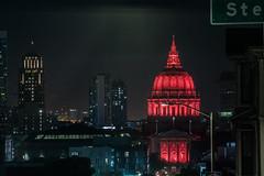 city hall illuminated in red lights (pbo31) Tags: bayarea california nikon d810 color april 2019 boury pbo31 spring sanfrancisco city night dark black red cityhall civiccenter alamosquare over