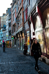 View of architecture of shops and people on streets with Ancient houses in the Old Town of Rouen city, the capital of Normandy region in France-85a
