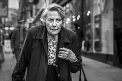 Buchanan Street (Leanne Boulton) Tags: urban street candid portrait portraiture streetphotography candidstreetphotography candidportrait streetportrait streetlife old elderly woman female lady face eyes expression emotion walking shopping sociallandscape tone texture detail depthoffield bokeh naturallight outdoor light shade city scene human life living humanity society culture lifestyle people canon canon5dmkiii 70mm ef2470mmf28liiusm black white blackwhite bw mono blackandwhite monochrome glasgow scotland uk