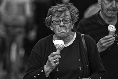 Too cool (Frank Fullard) Tags: frankfullard fullard candid street portrait cool lady monochrome black white blanc noir icecream dessert face expression lol fun gellato cone