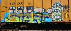 Start (rabidscottsman) Tags: scotthendersonphotography start startgraffiti graffiti railroadgraffiti rr railroad boxcar train tbox 66 28 86 662886 colors colorful face teeth brains mn minnesota northfieldminnesota ricecountyminnesota bench benched benching nikon nikond7100 d7100 tamron tamron18270 70k paintingsteel rollingart platef art artistic holysaturday frown