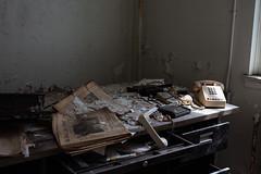 1996 Newspaper and Dial Phone (rantropolis) Tags: abandoned hospital asylum washington dc general newspaper phone dial office desk urbex urbanexploration semi nikon d750 50mm