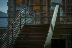 light and glass and stair (Robert Borden) Tags: stairs stairway architecture glass light metal railing la losangeles urban city street socal california usa northamerica fujifilmxt2 fujifilm 50mm 50mmlens 50mmphotography primelens prime goodlight shadow texture detail