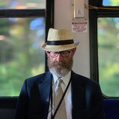 Man on the Bus (Packing-Light) Tags: bus publictransportation man hat beard commute portrait candid people iphonography iphone