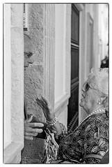 Caught in conversation (K.Pihl) Tags: streetphotography analog pellicolaanalogica spain hc110b monda overexposedoverdeveloped people monochrome blackwhite schwarzweiss bw kodaktrix400200 film olympusom4 zuiko85mmf20