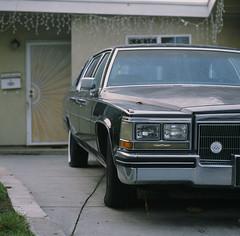 Santa Clara, California (bior) Tags: hasselblad500cm provia100f provia hasselblad mediumformat 120 6x6cm square santaclara house suburbs residential car driveway cadillac