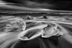 Black Diamonds (- Etude -) Tags: iceland ice icebergs zachchang sony sonyalpha monochrome longexposure sky beach diamond movement waves white black sand