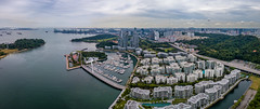 Panorama aerial view of keppel bay with modern residence in Singapore city. (MongkolChuewong) Tags: aerial aerialview architecture bay boat building business city cityscape complex condo condominium cruise design drone export golfcourse harbor import international island keppel landmark landscape lifestyle luxury modern panorama park port residence residential resort rich river sea sentosa ship singapore singaporecity singaporean skyline skyscraper technology transport transportation travel urban view yacht