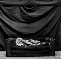Street - Sleeper (François Escriva) Tags: street streetphotography paris france people candid olympus omd photo rue colors sidewalk black white bw noir blanc nb monochrome sofa sleep sleeper man cobblestone