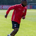 Nahaufnahme vom sprintendem Fußballspieler und Stürmer des 1. FC Köln Jhon Córdoba auf dem Trainingsplatz am Geißbockheim Clubhaus