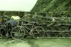 Pennan, Scotland: Bike & Lobster Traps (rocinante11) Tags: bike bicycle lobster pennan scotland film filmcamera fujifilm fujiprovia xpro crossprocess