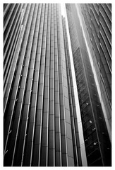 Verticals (Dave Button) Tags: london city architecture vertical xe2 xe2s fuji fujifilm 27mm bw mono monochrome building lines