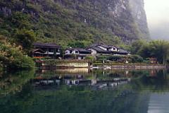 (Elena Miari) Tags: yangshuo mountain retreat mountains china chinese river riverbank touristoboat view hotel mist misty fog foggy tourism holidays winter waterscape