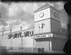 Sportland - New55 negative (thereisnocat) Tags: new55 speedgraphic instant roidweek roidweek2019 boardwalk arcade sportland fun4all oceancity maryland md negative