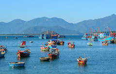 Wooden boats on Nha Trang Bay (phuong.sg@gmail.com) Tags: asia asian attractions bay beach blue boat brine cambodia cloud comfortable concept fisherman fishing holiday hot indochina industry landscape leisure light ocean relax relaxation rest sand scenery sea season ship sky summer sun sunny thailand tourism travel tropic tropical vacation vietnam warm water
