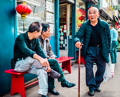 Street - Paris Chinatown (François Escriva) Tags: street streetphotography paris france people candid olympus omd photo rue colors sidewalk men man asian asians chinatown belleville stick old elder bench green blue red wall shop bag