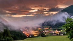 Alice in Wonderland (Neha & Chittaranjan Desai) Tags: dolomiti dolomites italy landscapes travel twilight valley fog sky colors village mist