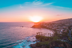 Aerial view over Crescent Bay in Laguna Beach at sunset overlooking Orange County beaches. (Zutila, Inc.) Tags: aerial orange county california sunset laguna beach heisler park skies sky pacific photography landscape drone view pink ocean cinematic red mountains travel blue outdoors sea reflection vacation coast usa destination shore waves dusk dawn twilight fiery above coastal lit amazing beautiful lagunabeach unitedstatesofamerica