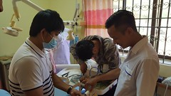 Dentists replacing fractured tubing with some brought from Phnom Penh - Koh Kong