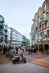 One of Amsterdam Streets (Top KM) Tags: ifttt 500px street city road outdoors people houses cars bicycles amsterdam netherlands urban travel building holland town europe the old daytime day daylight outdoor outside house scene exterior life