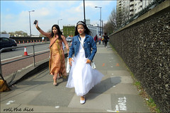 `2617 (roll the dice) Tags: london camden nw1 streetphotography pretty sexy girl sad mad fun funny surreal happy smile reaction people fashion sunny weather urban unaware unknown uk classic art england canon tourism tourists portrait strangers candid shopping natural light shadows legs face eyes life wisdom tiara wedding bride family asian girls hampsteadroad headband run late mehndi henna taxi traffic sari cones mobile phone talk wall