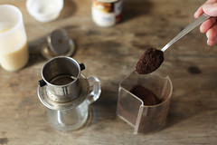 scooping coffee into metal filter, for Vietnamese coffee (HungryHuy) Tags: vietnamese food asian vietnamesecuisine vietnameseculture southeast coffee cafe ca phe sua da cafesuada iced condensed milk hot scooping du monde chicory drip filter phin nong caffeine
