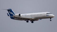 N699BR CRJ-200 SkyWest (SamCom) Tags: crj2 n699br crj200 skywest kdfw dfw foundersplaza