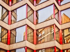Zigzig Redclad (Steve Brewer Photos) Tags: hungary budapest red building zigzag reflection reflections façade window windows