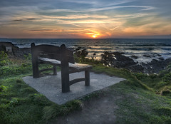 Watch the show from here (Through Bri`s Lens) Tags: northdevon croydebay beach bench rocks seat show sunset brianspicer canon5dmk3 canon1635f4 leereversegrad
