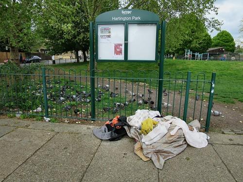 Dumped clothes at the southwest entrance to Hartington Park, Tottenham